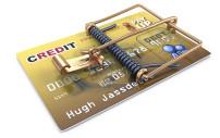Kreditkarte mit einer Mausefalle abgesichert